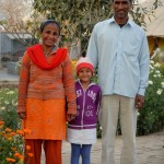 The two adults are former patients who now work at the Ashram (as a patient, the woman appears at 4:43 in this video: http://www.youtube.com/watch?v=c8GsQBevfBo). Their daughter is a daily face on the grounds of Sewa Ashram.