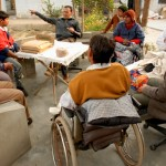 Many of the long-term disabled residents will be instrumental in establishing and maintaining the goat farm. Here, they meet to discuss the details of the project.