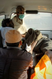 After loading everybody into the ambulance, Sarin keeps an eye on the three new patients.